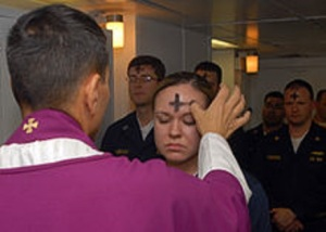 1 220px-US_Navy_080206-N-7869M-057_Electronics_Technician_3rd_Class_Leila_Tardieu_receives_the_sacramental_ashes_during_an_Ash_Wednesday_celebration